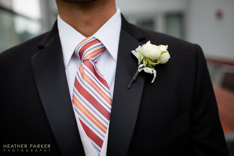 orange wedding tie on grroom at hotel