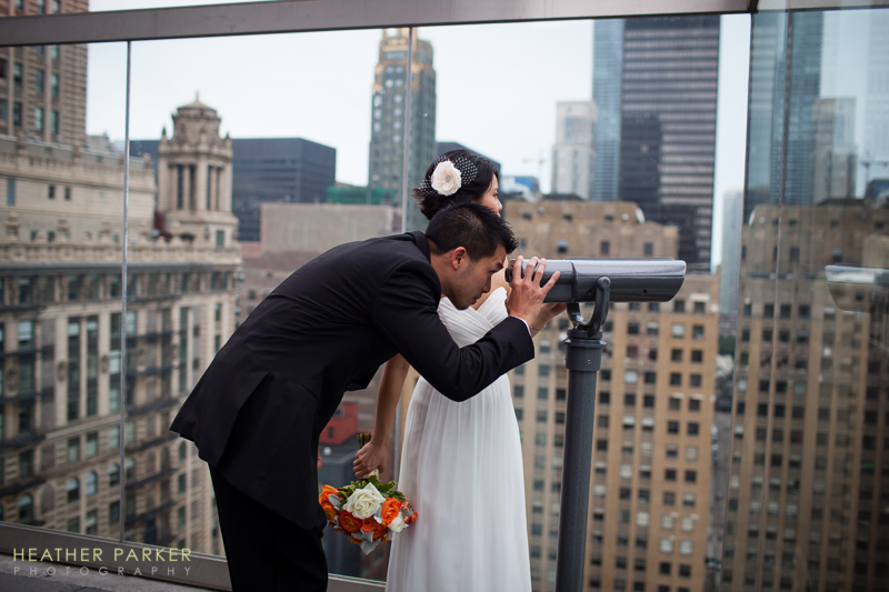 bride and groom at hotel rooftop