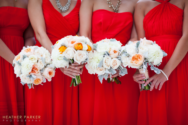 white flowers with red bridesmaid dresses