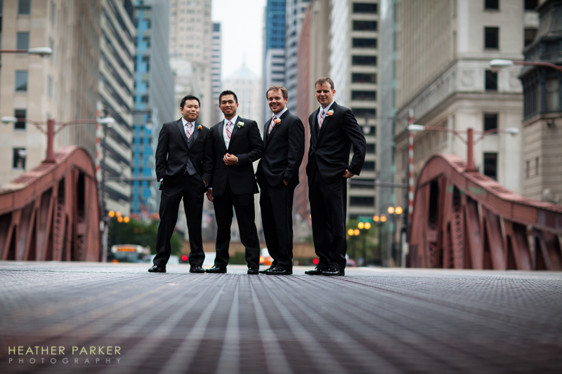 groomsmen on a bridge