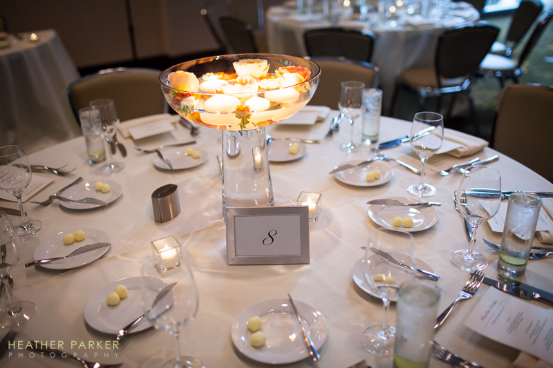 silver and white modern wedding reception decor with floating candle centerpieces