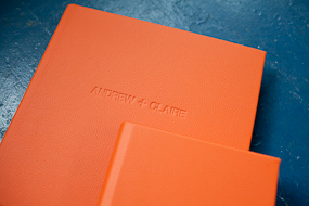 Queensberry wedding albums in tangerine orange shot by Boston photographer Heather Parker