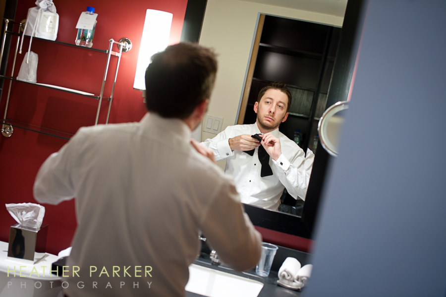 groom getting ready at W lakeshore for wedding