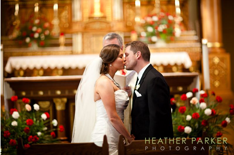 kiss at Saint Hedwig church wedding ceremony