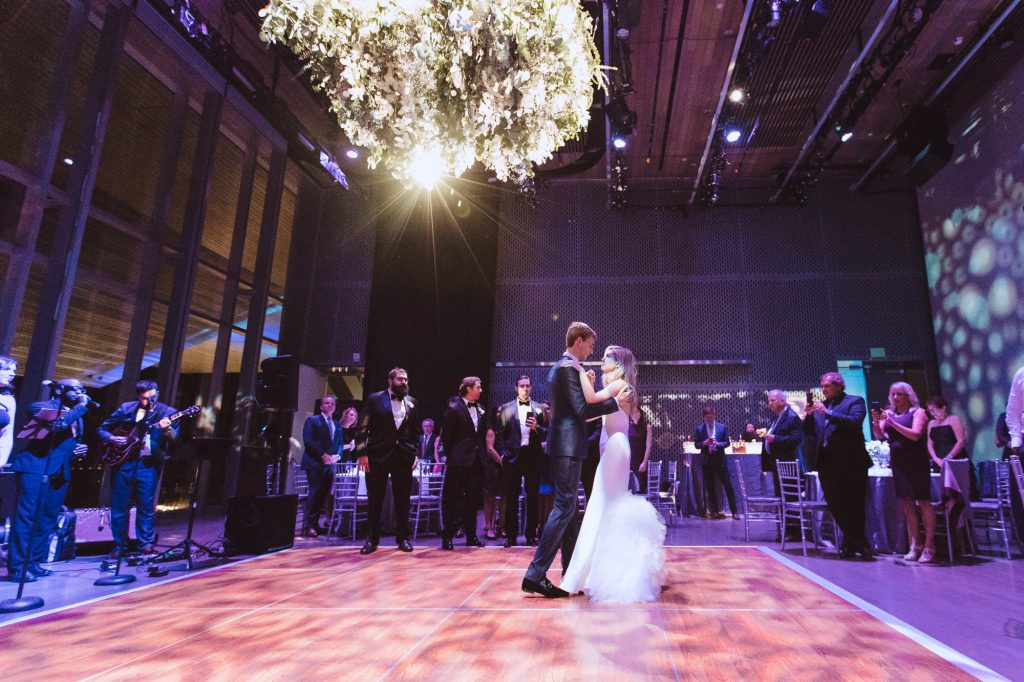 bride and groom enter the reception ballroom at the ICA museum in Boston for a modern wedding