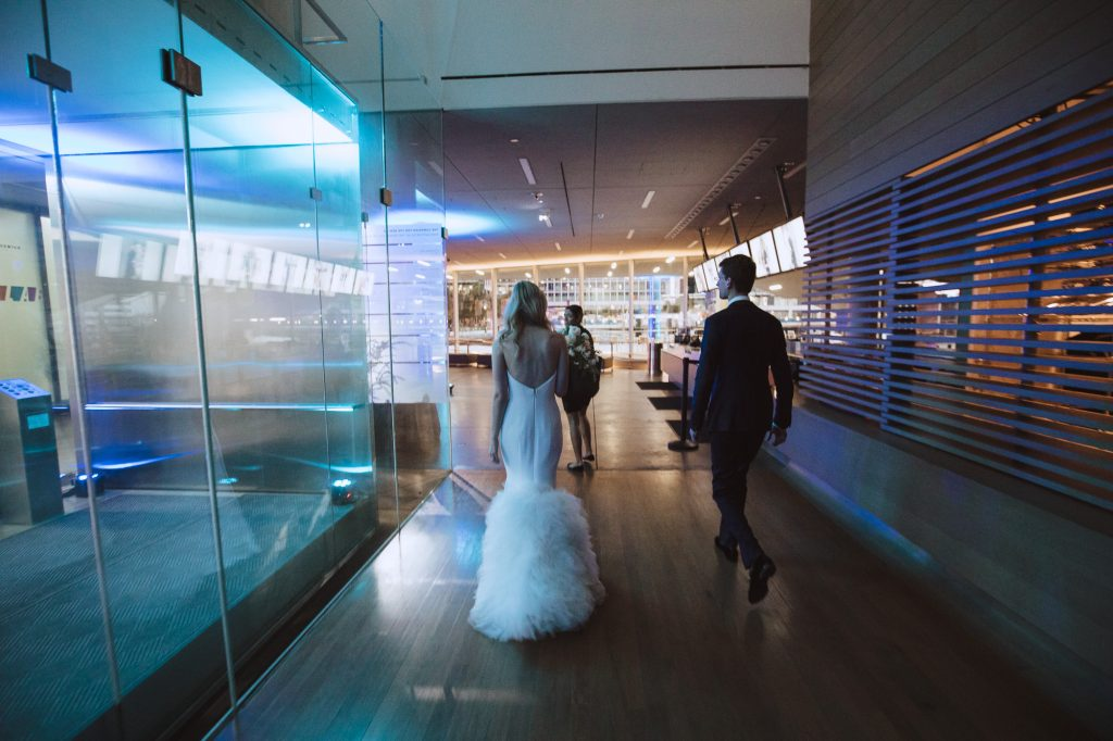 newlyweds enter their reception ballroom