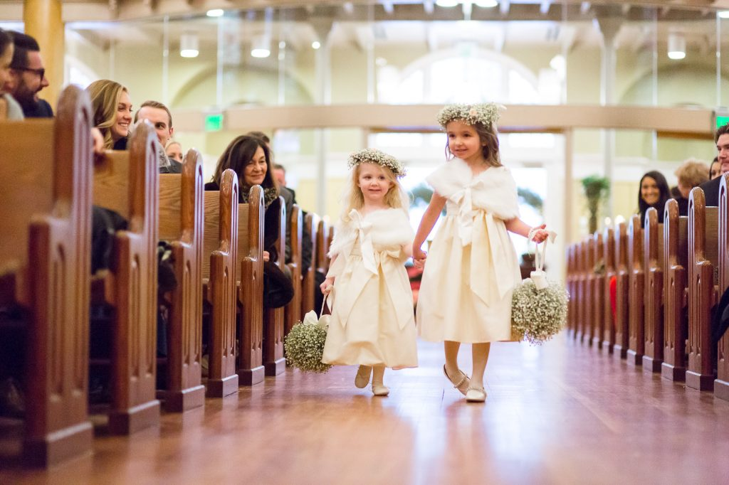 flower girls down the aisle in church at a Saint Cecilia Boston wedding