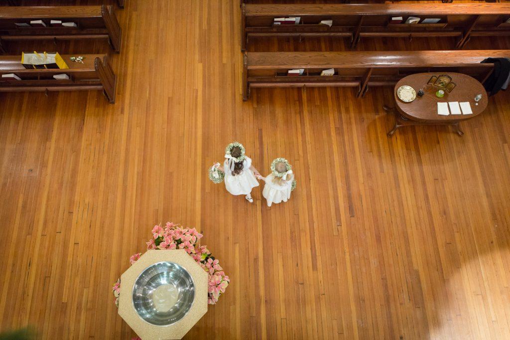 flower girls down the aisle in church at a Saint Cecilia Boston wedding